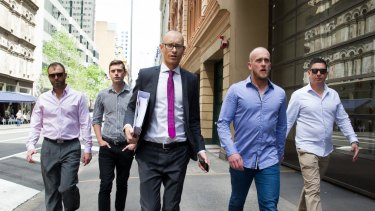 Shane Housego, Christian McDonald, Christopher Sheehy and Steven Rapisarda with lawyer Nicholas Stewart (centre).