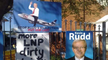 Dirty tricks: Signage wars broke out yesterday at Brisbane polling booths.