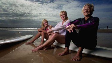 """Sands of time: Abbey Mae (left), her mother Alison and grandmother Elaine Reid surf together at Byron Bay. """"We were in the water before we could walk,"""" Alison says."""