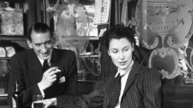 Threat to the natural order ... one of the UK's first female career journalists, Anne Scott-James, pictured in a pub in 1941.