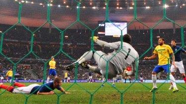 The winner . . . Karim Benzema (L) looks up after scoring a goal past Brazil's goalkeeper Julio Cesar.