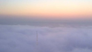 The Arts Centre spire pierces the fog in this picture taken the Eureka Tower.