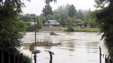 Flooded ... the Bellinger River at Lavender's Bridge in Bellingen.