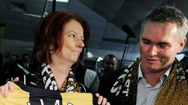 As they were ... Julia Gillard and Craig Thomson campaigning on the NSW central coast in August last year.