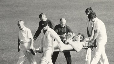 Terry Alderman is stretchered off after tackling a pitch invader.