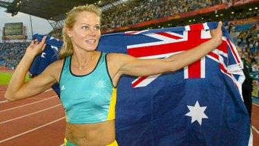 Glamorous aunt: Tatiana Grigorieva celebrates her 2002 Commonwealth Games gold medal.