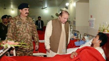 Pakistani Prime Minister Nawaz Sharif visits a student injured in the Peshawar school massacre.