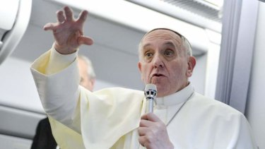 Pope Francis talks with journalists as he flies back to Rome after his visit to Brazil.