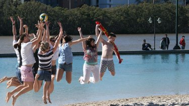 Beachgoers defy the cold weather for the reopening of South Bank's main pool over the weekend.