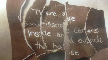 The ripped-up note found in Lisa Harnum's jean pocket.