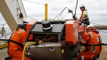 Last checks are done on the Dragon Prince deep tow fish prior to deploying it behind Fugro Discovery.