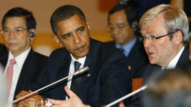 Barack Obama, left, listens Kevin Rudd at an APEC conference breakfast meeting.