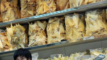 A man inside a shark fin store in Hong Kong.