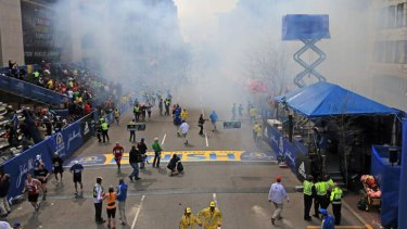 Smoke from one of the blasts can be seen clouding the finish line.