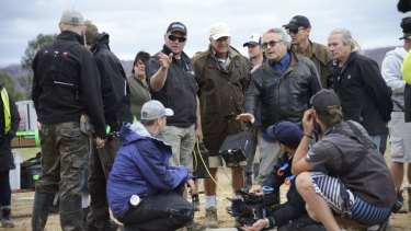 Action: George Miller and crew position cameras for some of the final shots for Mad Max.