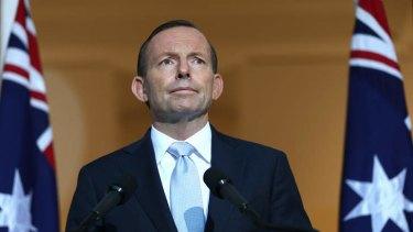Prime Minister Tony Abbott addresses the media on Friday. Photo: Alex Ellinghausen