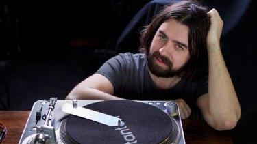 Clayton Pegus fixes old vinyl turntables.