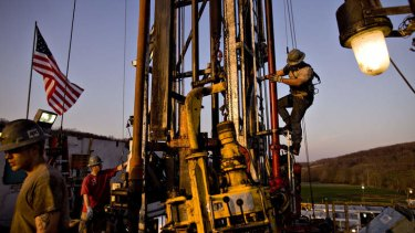 Workers attach pipes at a natural gas drill site in Bradford County, Pennsylvania.