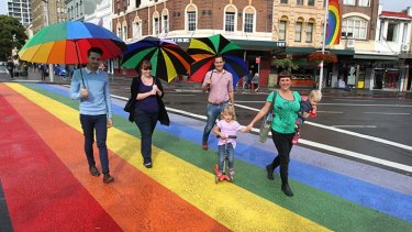 To go: (left to right) Luke Orrock, Leanne Abbott, Alex Greenwich and Megan Tordoff with daughters Tilda, 4, and Nell, 20 months, at the rainbow crossing at Oxford Street. The crossing could be removed as early as Tuesday night.