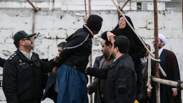 Saved by a slap ... Samereh Alinejad (right) hits Balal, who killed her son, during an execution ceremony in the northern city of Nowshahr, Iran.