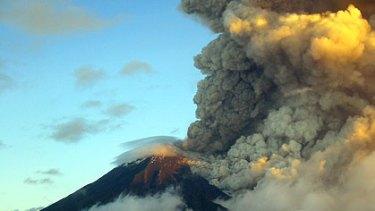 Ash rises from Ecuador's Tunguharua volcano in 2006.