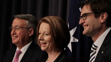 Prime Minister Julia Gillard, Deputy Prime Minister Wayne Swan and Climate Change Minister Greg Combet following the passing of the Carbon Tax bills through the Senate.