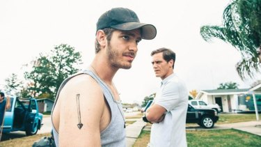 Andrew Garfield, left, and Michael Shannon  in <i>99 Homes</i>.