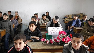A week after the ceasefire, children return to school - above, at Rafah Primary School for Boys in Rafah refugee camp - as Gazans try to regain a sense of a normal life.