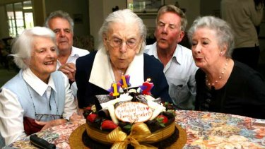 Piece of cake: Bea Riley, (centre) celebrates her 112th birthday with (left to right) her niece Bid Riley, nursing home manager Andreas Kazacos, son Cliff Riley and his wife Jueno.