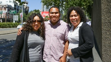 Chris Lee with sister Olivia (left) and mother Milli at the site of his stabbing in William Street.