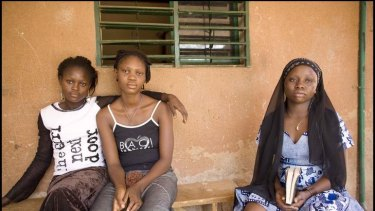 Rescued ... Magali, 15, and Shakira, 19, seated with Patience, were trafficked from Nigeria.
