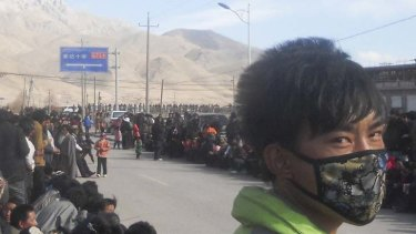 Beleaguered … ethnic Tibetans gather in Nangqian, Qinghai province, in support of independence for Tibet.