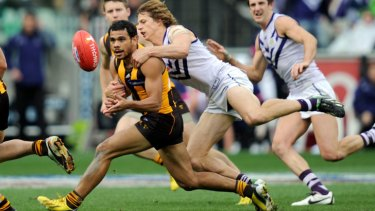 Hawthorn's Cyril Rioli chased by Fremantle's Nathan Fyfe at the 2013 AFL grand final.
