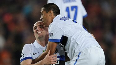 Inter Milan's Ivan Cordoba and Esteban Cambiasso celebrate their win over Barcelona, securing them a place in the Champions League semi-final.