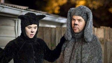 Biting back ... a feline-costumed Kestie Morassi with Wilfred (Jason Gann).