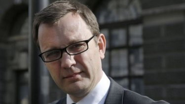 Former editor of the <i>News of the World</i> Andy Coulson leaves the Old Bailey courthouse in London.