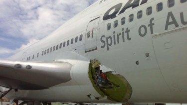 Emergency landing: A Qantas jumbo shows its damaged fuselage in Manila in July 2008.