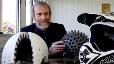 Physicist and inventor Don Morgan with the cone-head design which he invented to line the motocross and bike helmets.