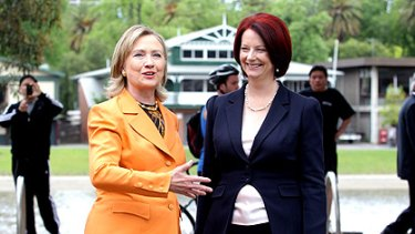 Time out: US Secretary of State Hillary Clinton and Prime Minister Julia Gillard take a moment between meetings for a stroll along the Yarra yesterday.