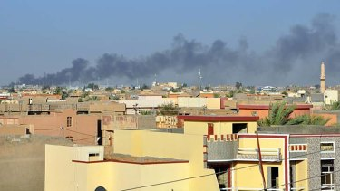 Smoke rises from buildings after shelling on the Iraqi city of Fallujah, west of the capital Baghdad, which has been held by anti-government fighters for more than four months.