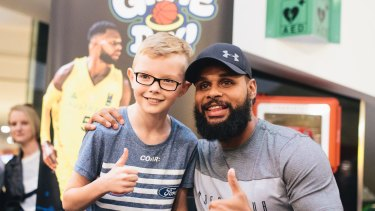 Patty Mills at Belconnen for a book signing for his new book Game Day. Patty Mills congratulates Logan Harrison after Logan beat Mills in a shootout.