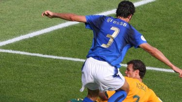 Fabio Grosso goes down after a challenge by Lucas Neill during the 2006 World Cup.