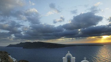 Thirassia Island is seen from the village of Oia in Santorini, Greece. An ideal spot to while away the golden years.