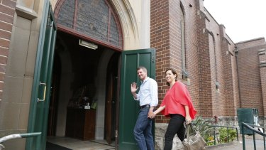 Mike Baird, with wife Kerryn, arrives at St Matthew's Anglican Church in Manly.
