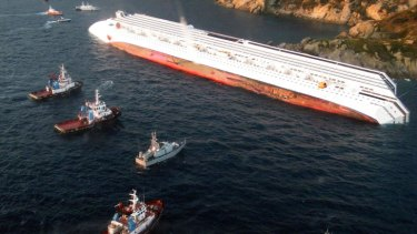Death scene ... An aerial view of the Costa Concordia, after the cruise ship ran aground off the Isola del Giglio.