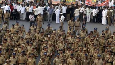 Protestors escorted by police march against the Sri Lankan Government. Picture: Reuters.