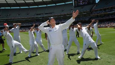 Garden party ... off-spinner Graeme Swann leads his England teammates doing the Sprinkler dance on the MCG after retaining the Ashes yesterday.