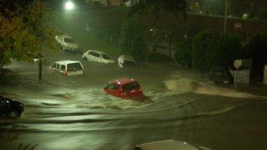 Cars floating down a flooded Dolphin Street, Coogee, on the evening of Saturday May 2.