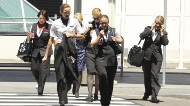 Qantas staff leaving Sydney international airport.
