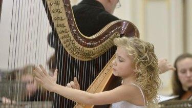 Something extraordinary: harpist Alisa Sadikova, 11, will perform at City Recital   Hall with three other internationally renowned harpists.